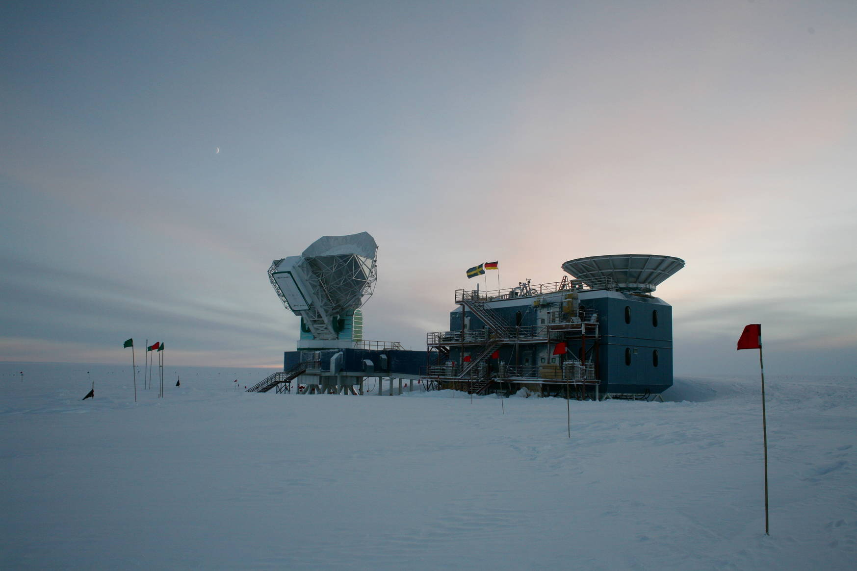 The South Pole Telescope during the sunset (opposite from the sun). Did you notice the moon?