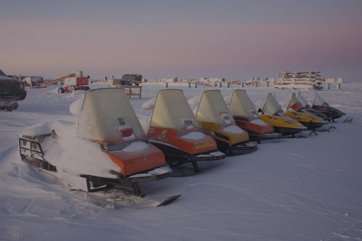 A row of snowmobiles.