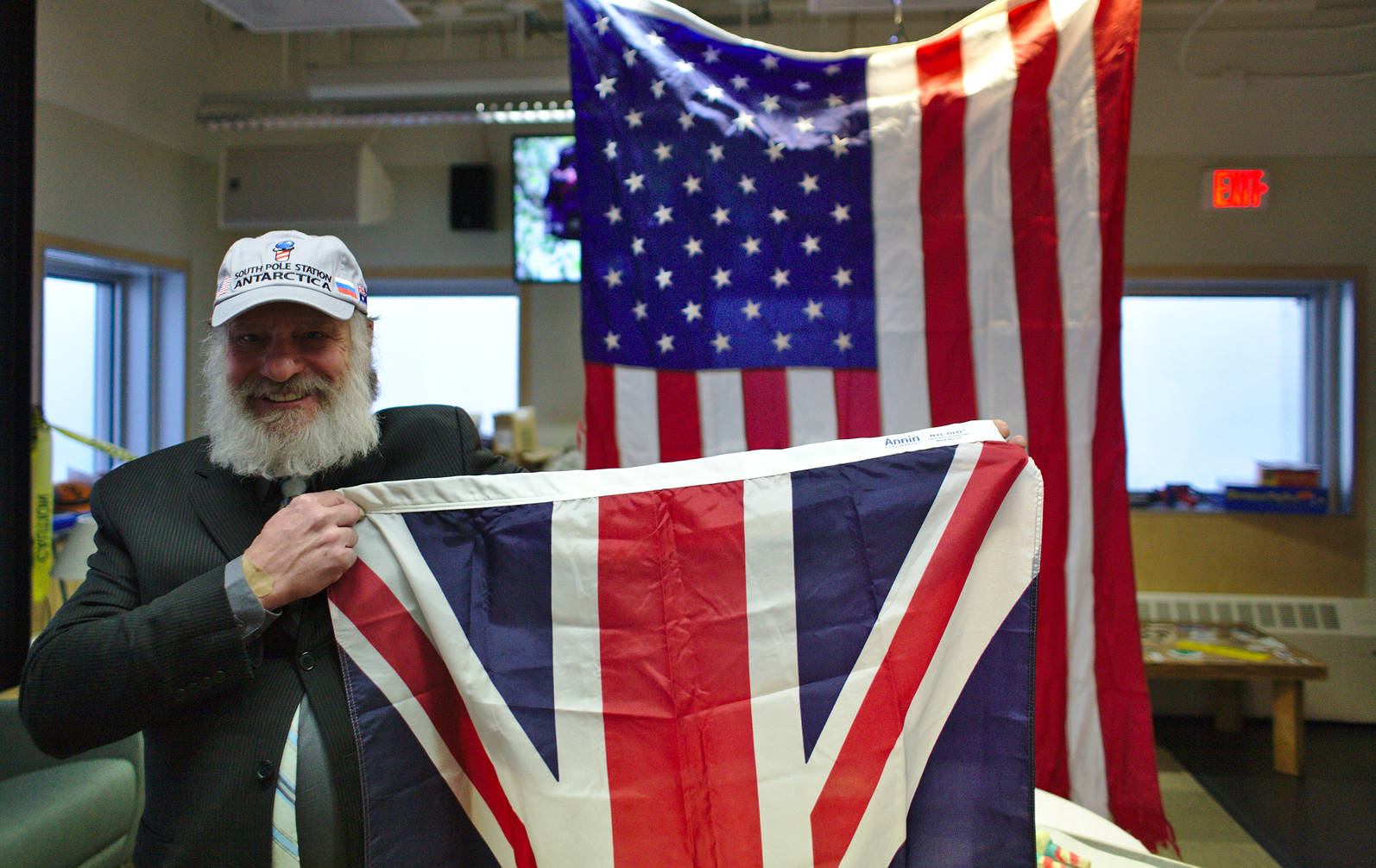 Rick happily presenting the UK flag that was flown at the ceremonial pole throughout the winter. Behind him the station flag.