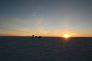 The South Pole Telescope and the setting sun.