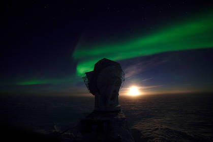 Early May, the moon behind the South Pole Telescope. The auroras were so strong that night that they were visible despite the glaring moon light.